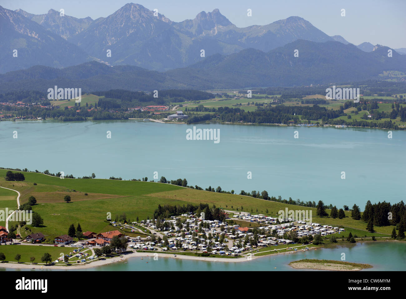 camping ground in Brunnen and Koenig Ludwig Musical at Forggensee, alps in the background, Germany, Bavaria, Allgaeu - Stock Image