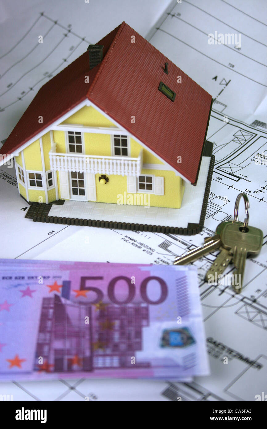 private residential building model, euros and keys - Stock Image