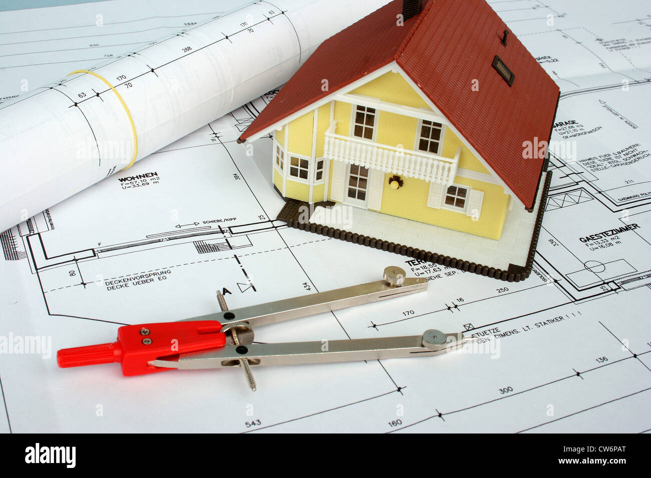 dividers and  model of a house lying on a plan - Stock Image