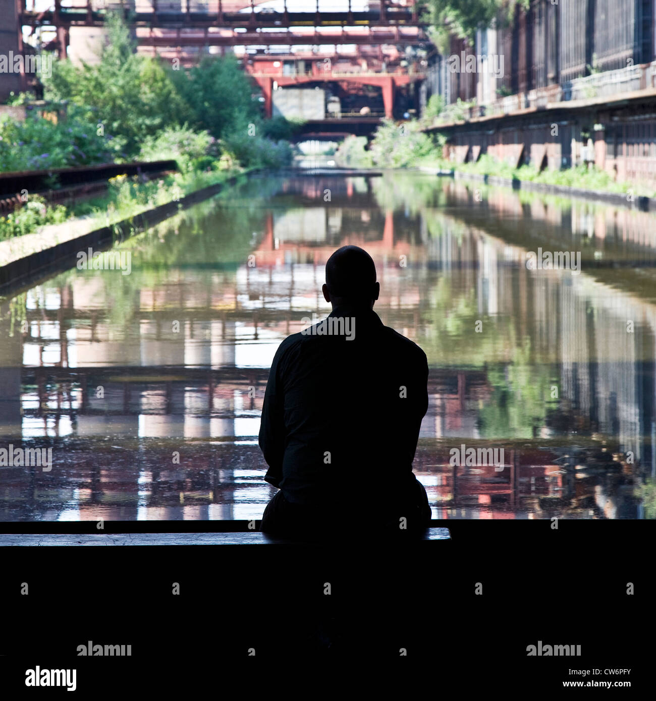 man looking at Kokerei Zollverein, Essen-Katernberg, Germany, North Rhine-Westphalia, Ruhr Area, Essen - Stock Image