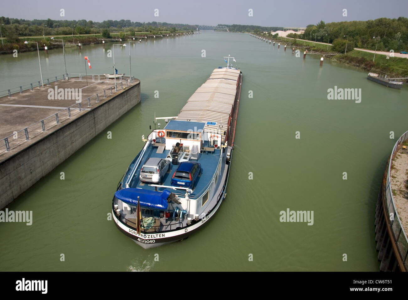 Iffezheim IWT - exit of a barge from the lock - Stock Image