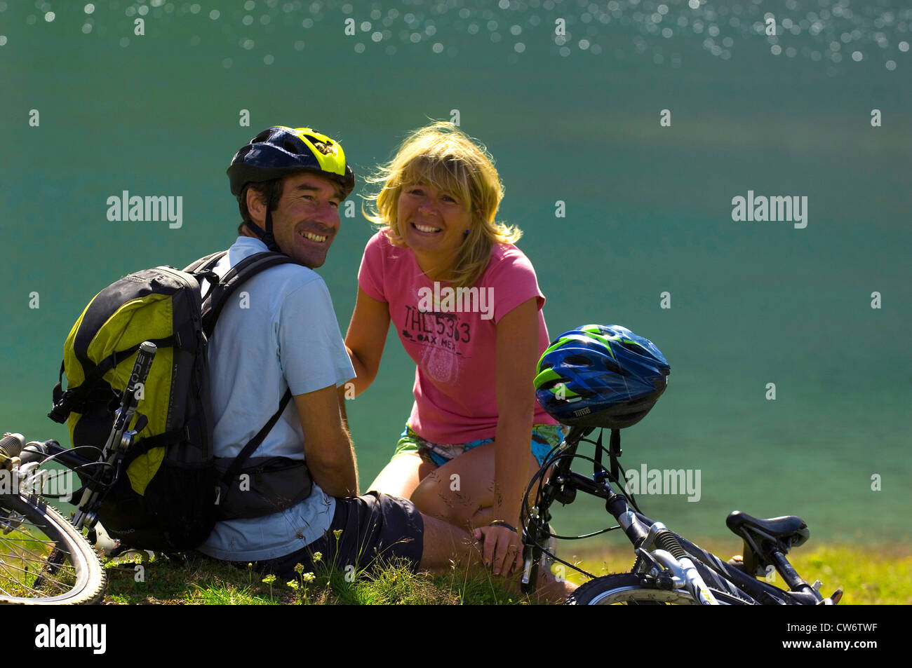 couple taking a break during a bicycle tour, France Stock Photo