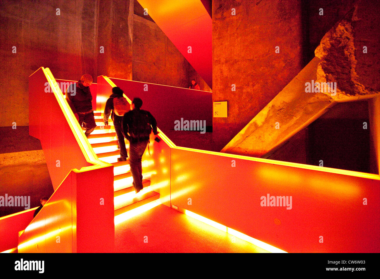 people in a staircase of coal plant Zollverein, Germany, North Rhine-Westphalia, Ruhr Area, Essen - Stock Image