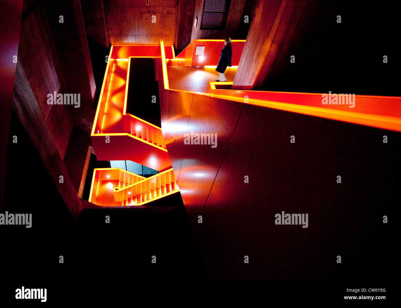 person in a staircase of coal mine Zollverein, Germany, North Rhine-Westphalia, Ruhr Area, Essen - Stock Image