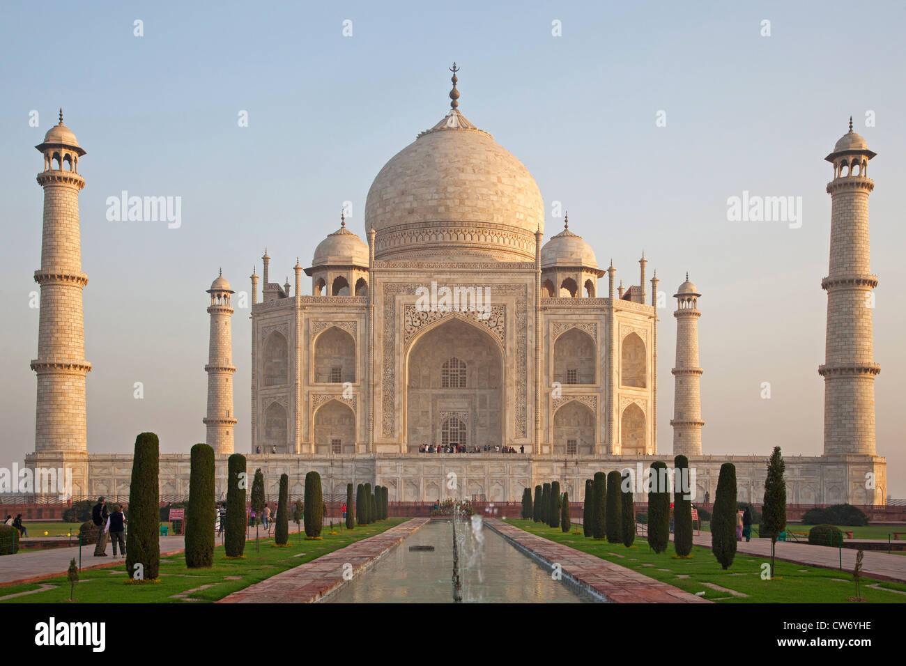 Tourists visiting the Taj Mahal, white marble palace in Agra, Uttar Pradesh, India - Stock Image