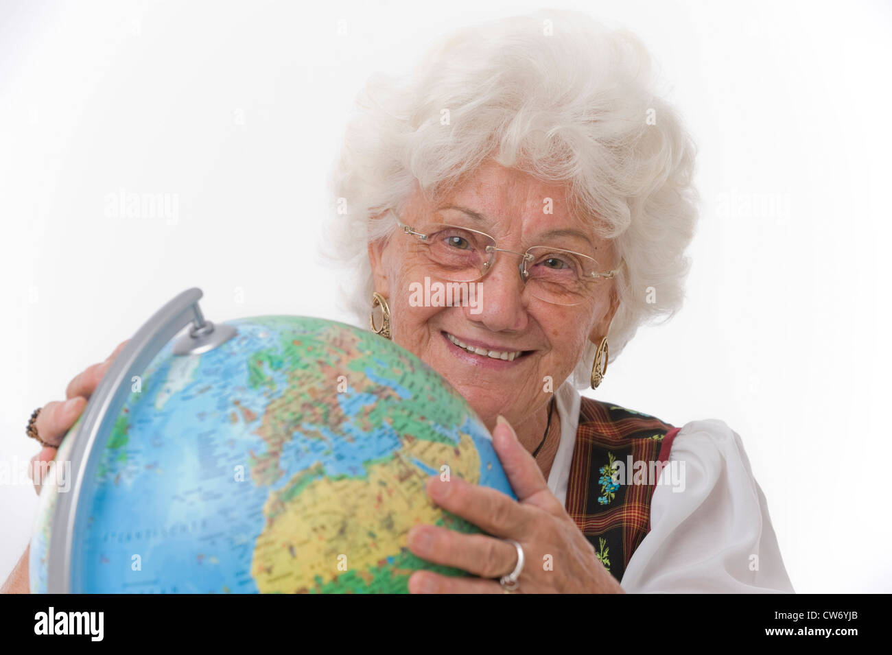 older person with globe - Stock Image
