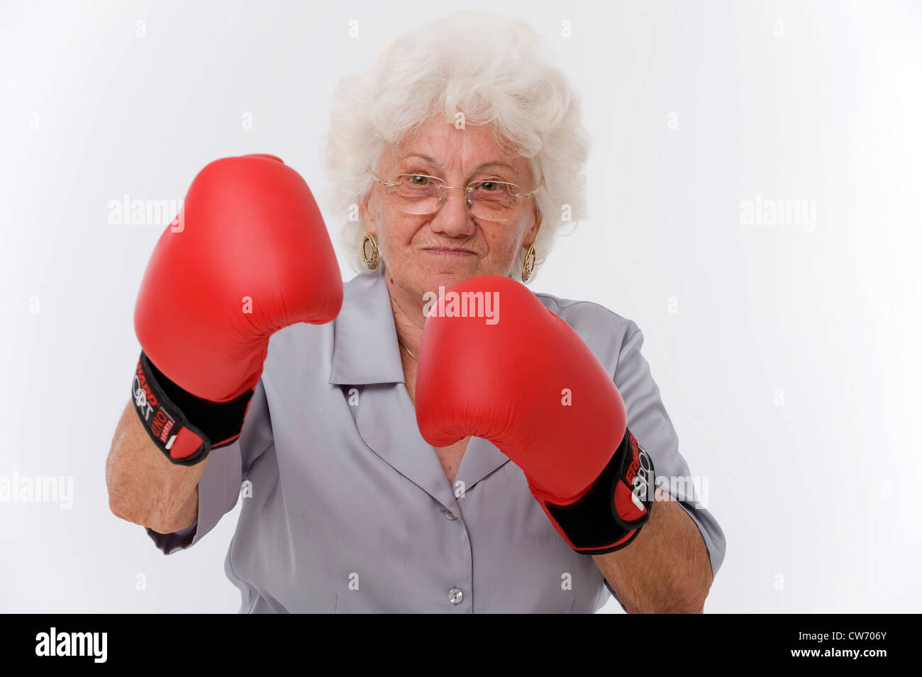 old woman wih boxing gloves - Stock Image