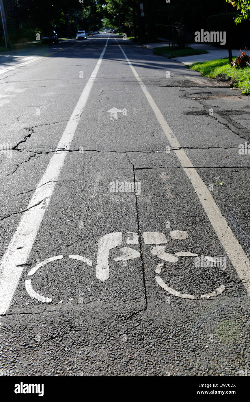 Bike lane symbol on city street. New Haven, CT. - Stock Image