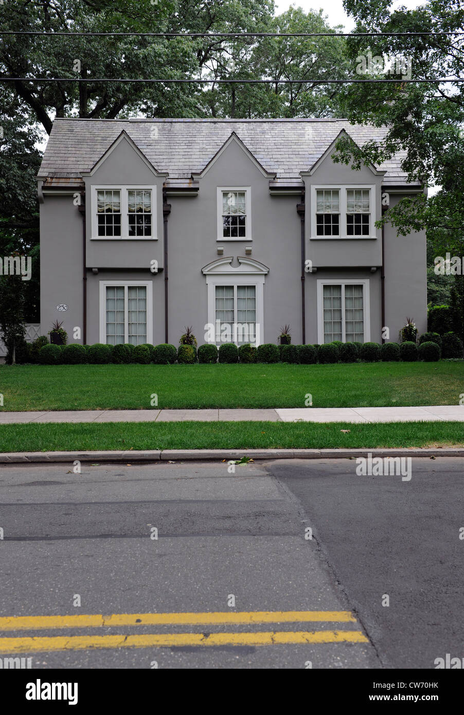 Stucco house with green lawn. New Haven, CT. - Stock Image