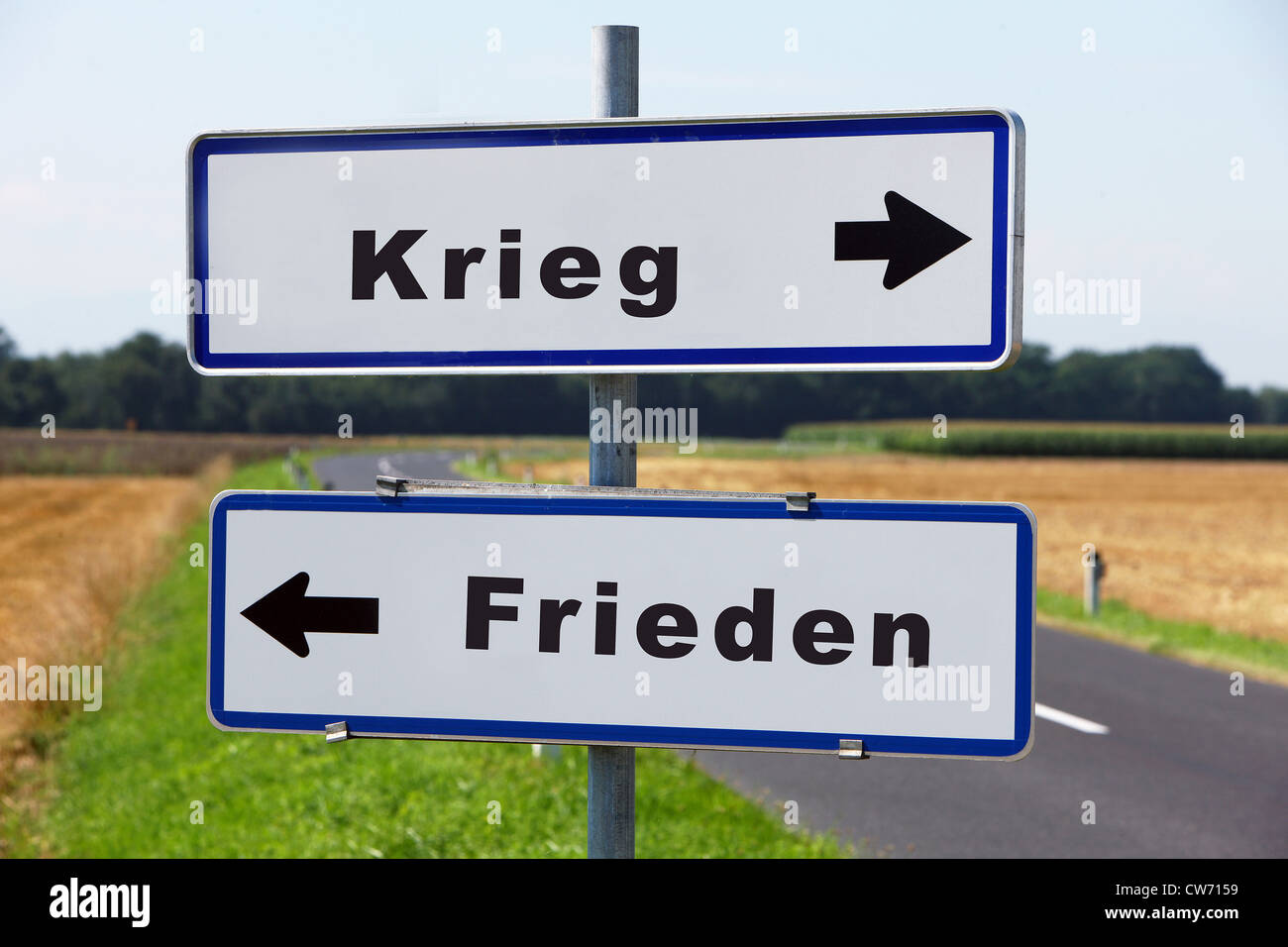 road signs Krieg - Frieden, war - peace - Stock Image