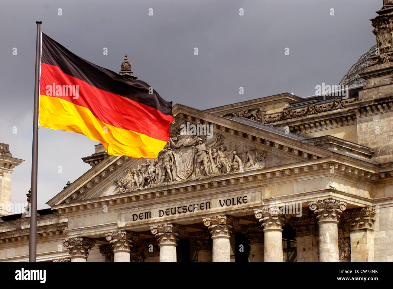 german flag in front of the Reichstag, 'dem deutschen Volke', Germany, Berlin - Stock Image