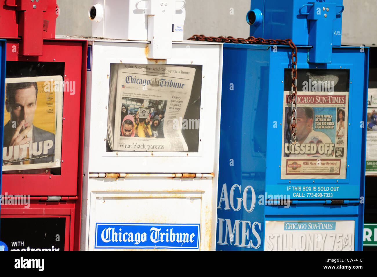 Chicago,  Illinois, USA. Patriotic colored newspaper boxes including those of the two Chicago daily newspapers at - Stock Image