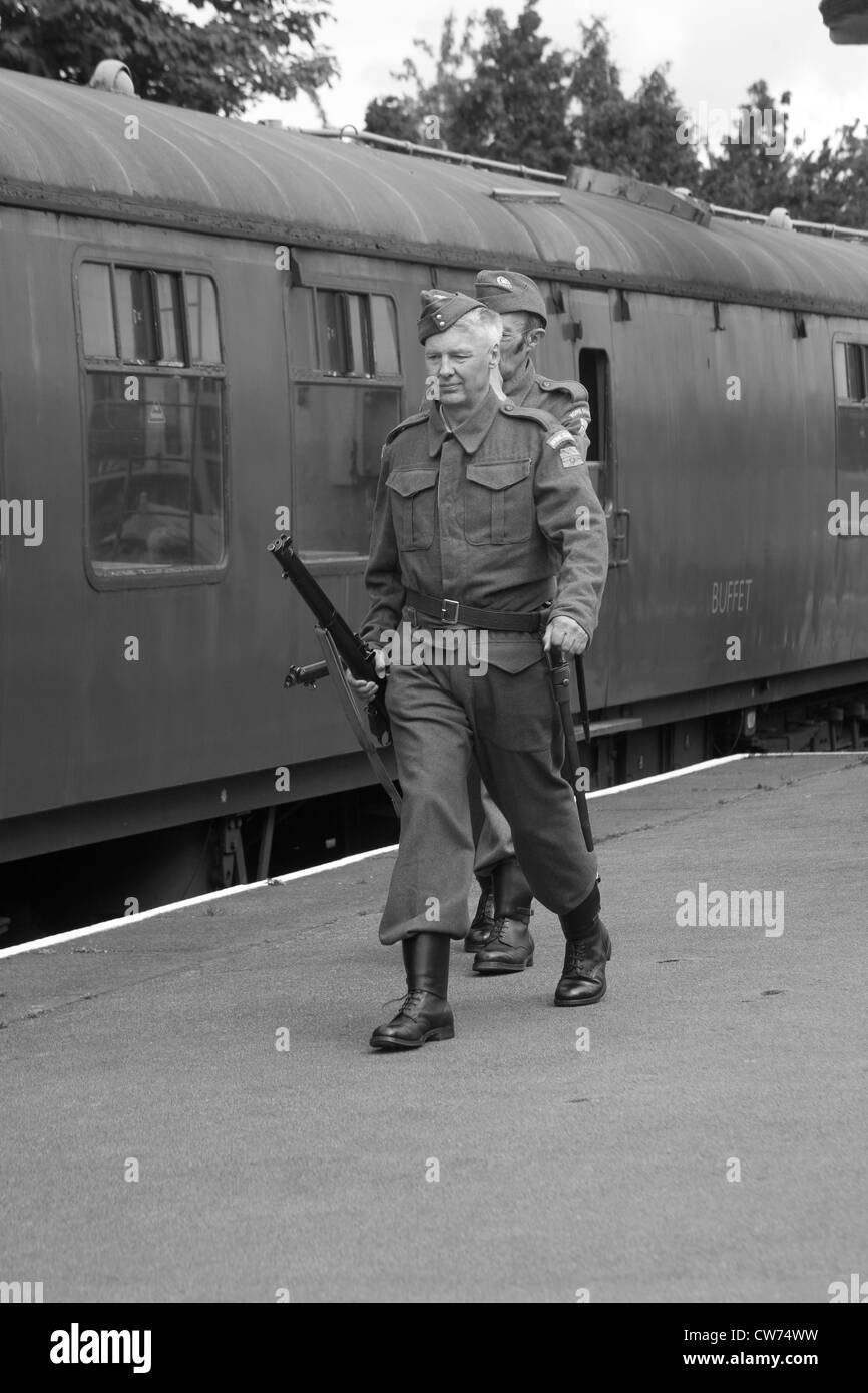 Home Guard on platform with train - Stock Image
