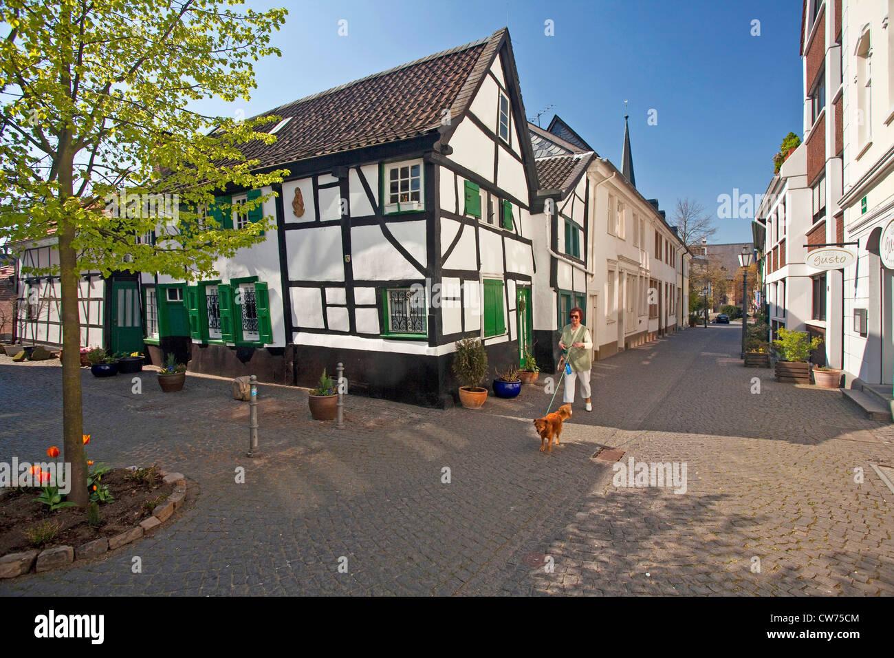 woman walking her dog in the old city of Muelheim/Ruhr, Germany, North Rhine-Westphalia, Ruhr Area, Muelheim an - Stock Image