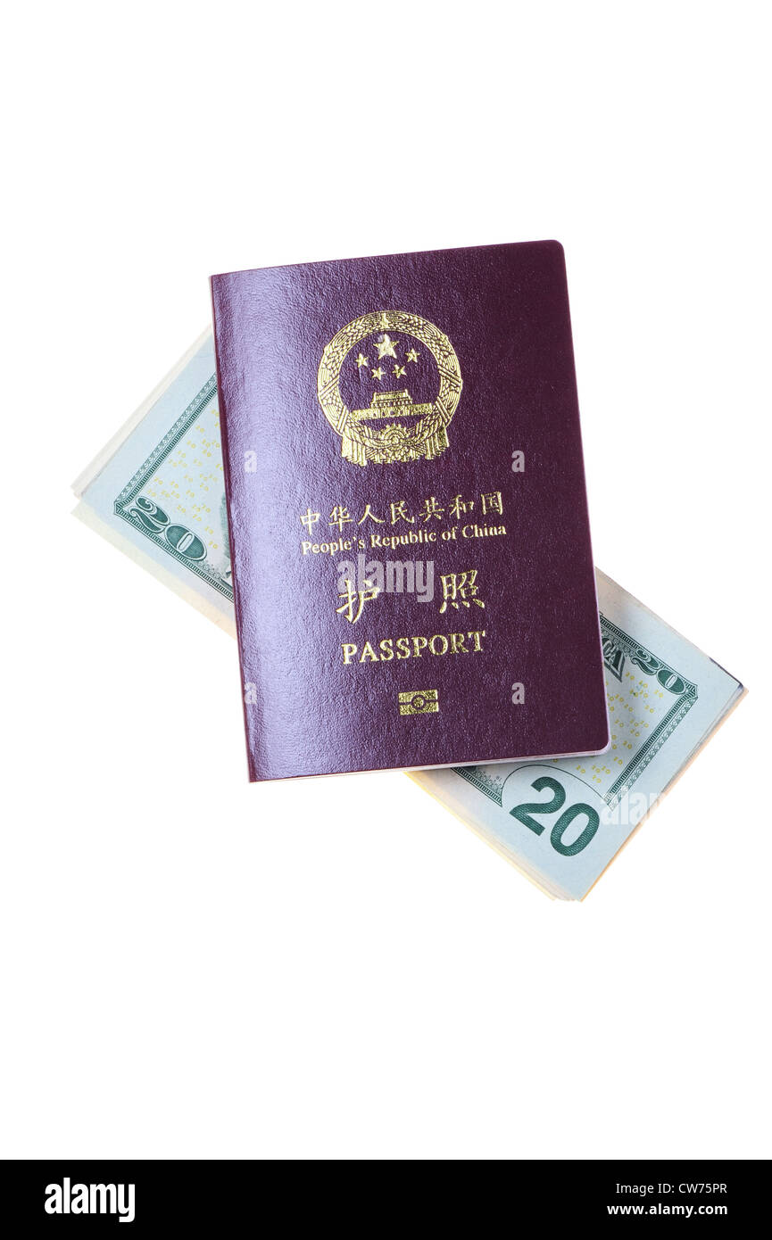 Chinese passport and a pile of US Dollars isolated on white - Stock Image