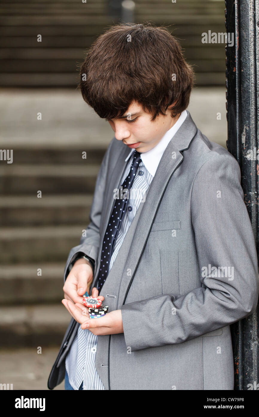 Young gambler counting his winnings - Stock Image