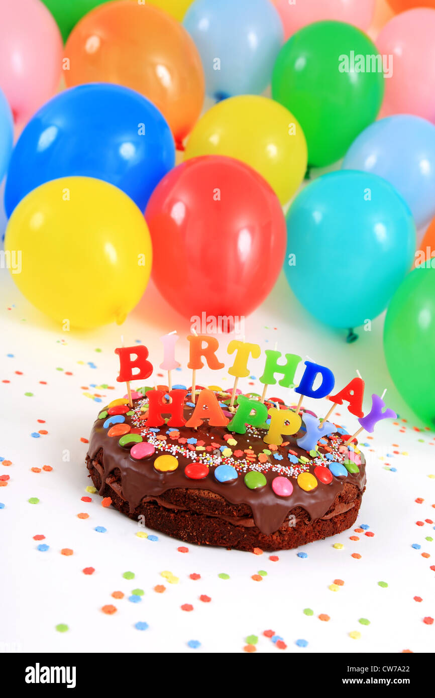Happy Birthday Chocolate Cake With Candles And Balloons Stock Photo