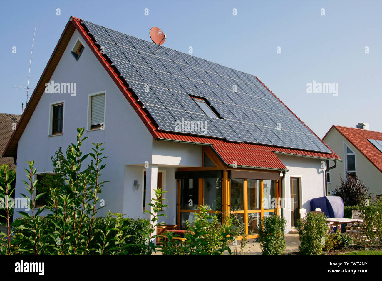 house with photovoltaic on the roof, Germany, Bavaria, Eckersdorf - Stock Image