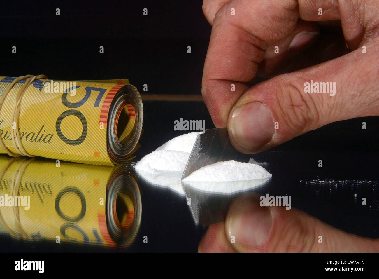 packet of banknotes and cocaine - Stock Image