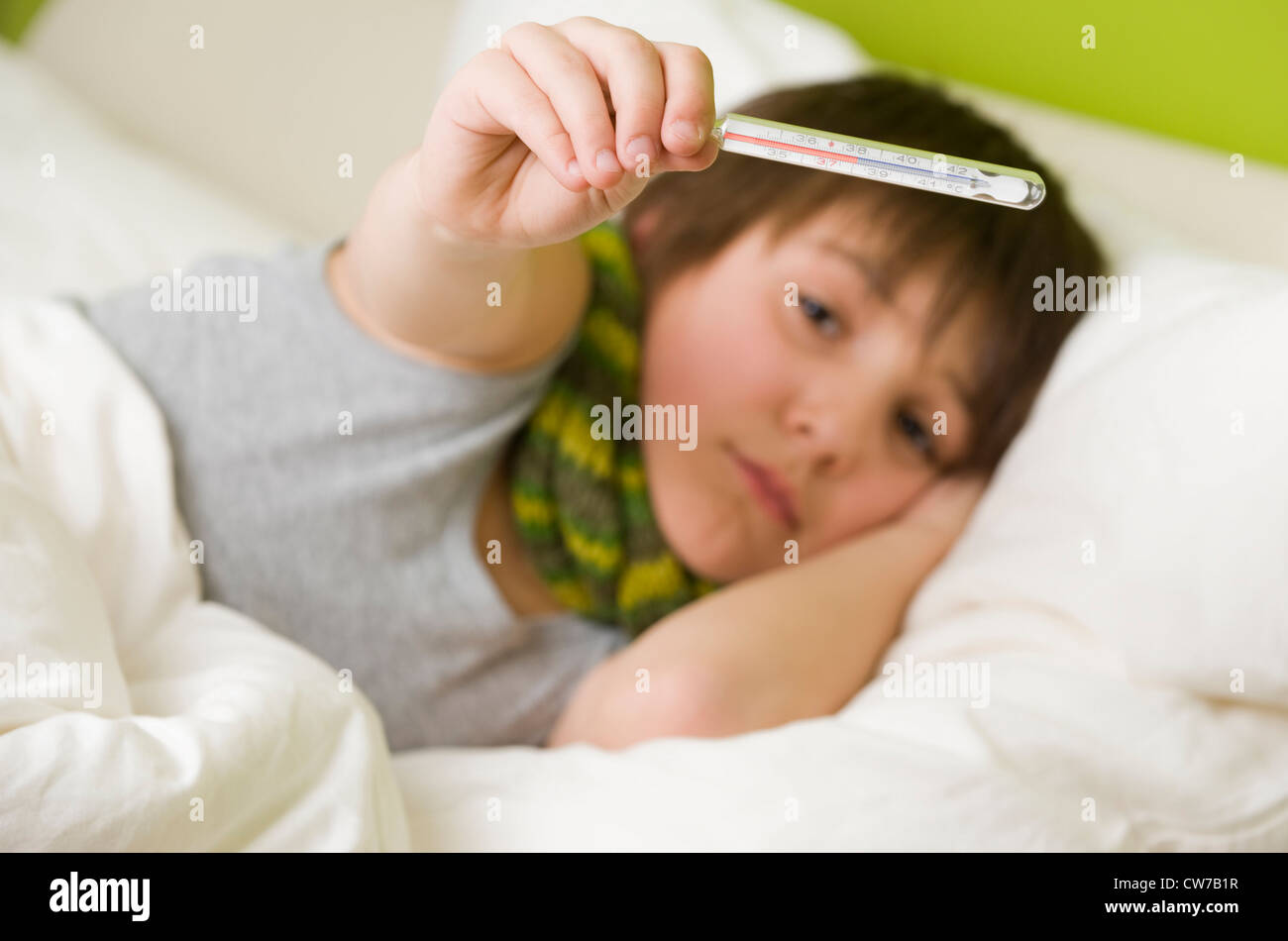 sick boy with fiver in bed - Stock Image