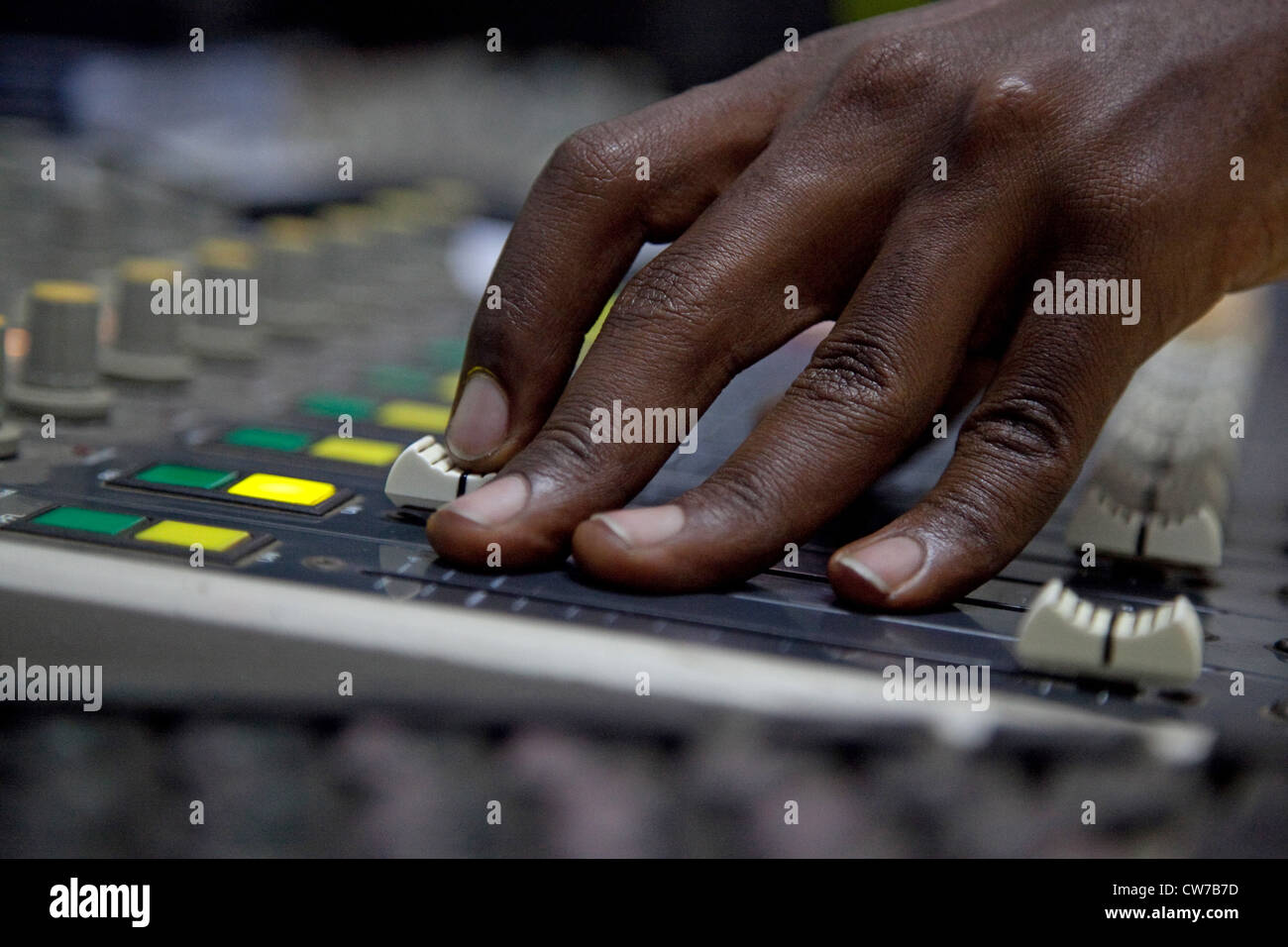 hand of a audio engineer at the mixer at the radio station 'Radio Isanganiro' popular in the country, Burundi, - Stock Image
