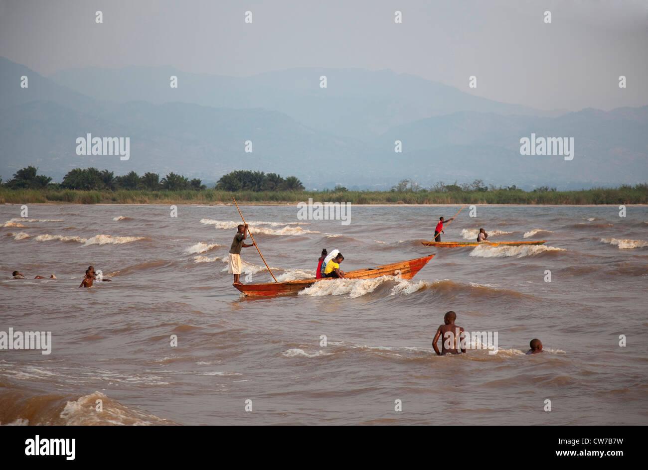 children swimming and boating in Lake Tanganyika, Burundi, Bujumbura Mairie, Bujumbura - Stock Image