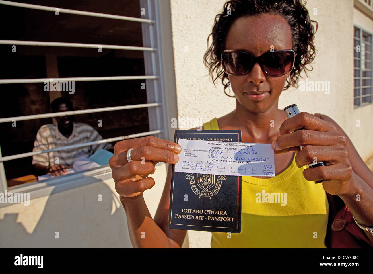 young woman has just become registered for the national election 2010 and is proudly presenting the written confirmation - Stock Image