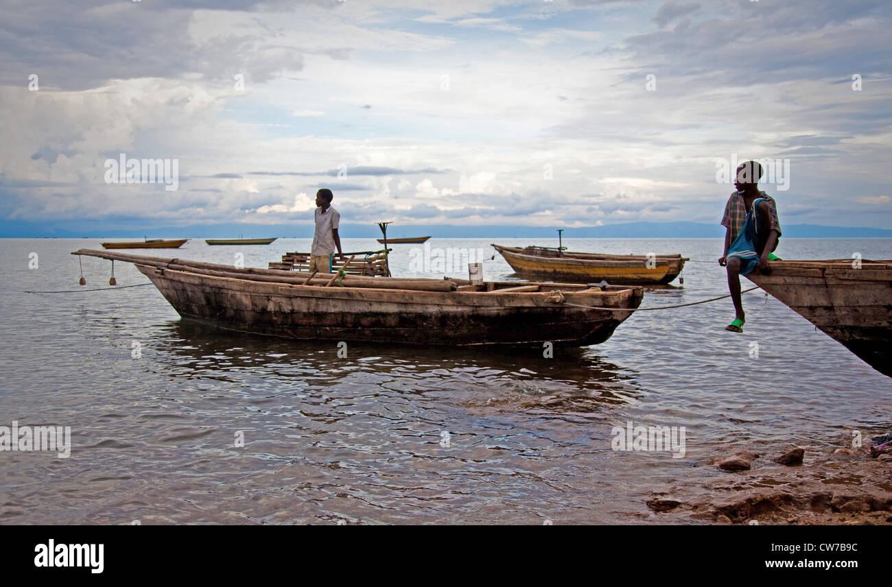 two boys on fishing boats at Lake Tanganyika, Burundi, Makamba, Mvugo, Nyanza Lac Stock Photo