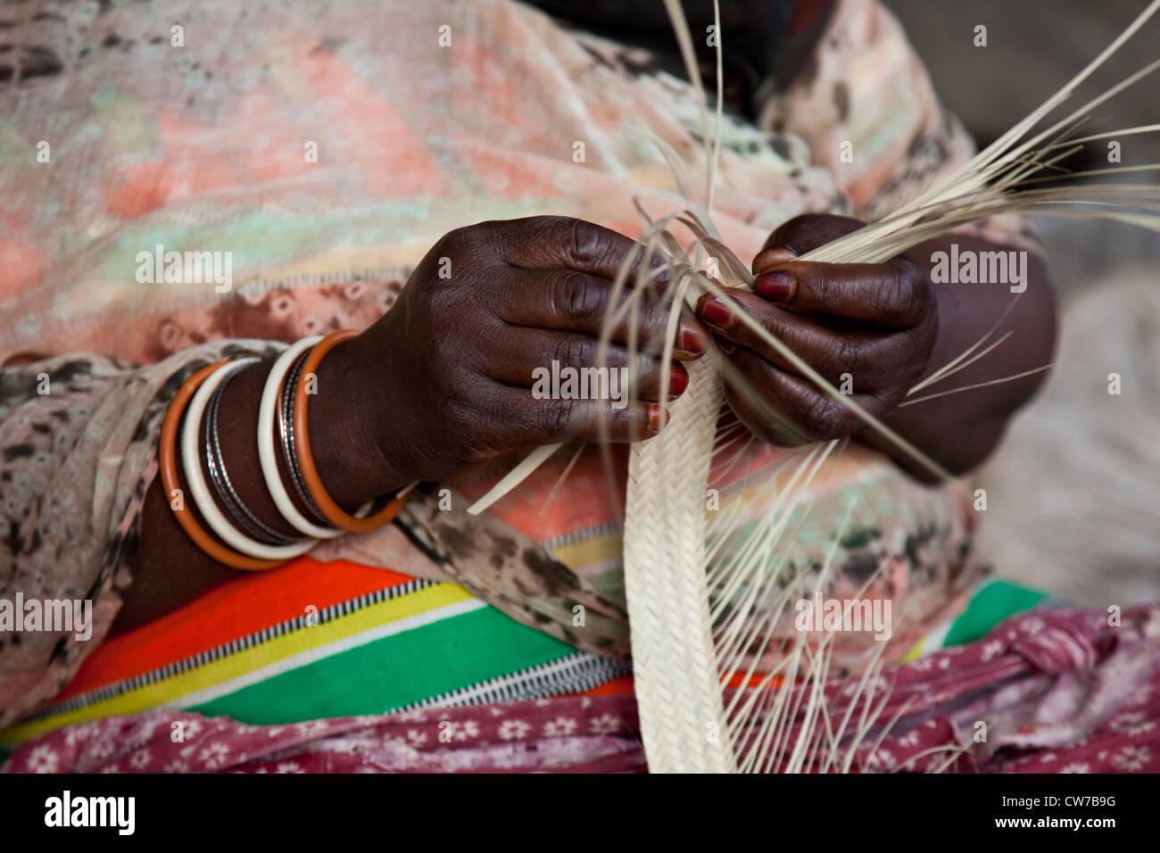 woman braiding a basket on a market, detail, Rwanda, Nyamirambo, Kigali - Stock Image