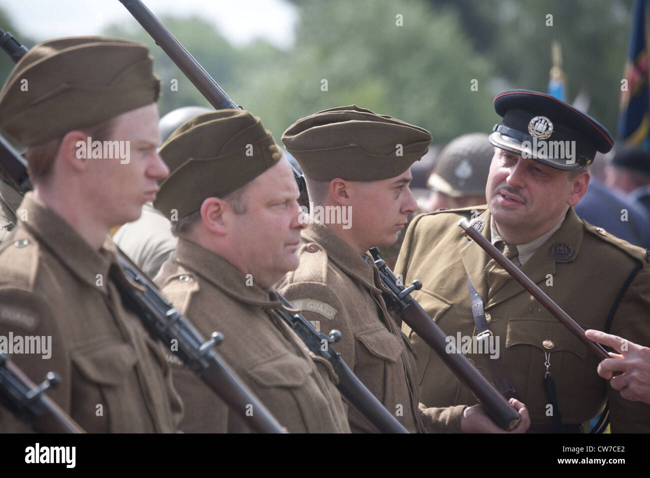 Re-enactor playing 1940's British and American Army Soldiers with others on parade Stock Photo