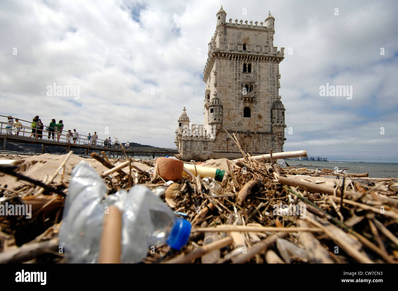 tower of Belem with dirty beach in the foreground, Portugal, Lisbon - Stock Image