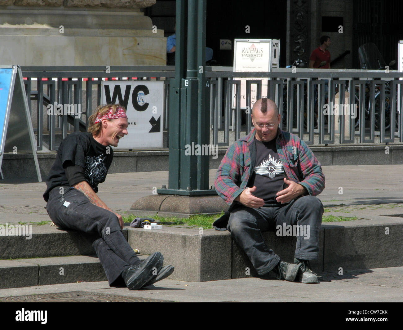 Workmen chatting laughingly during break in front of the city hall of Hamburg, Germany, Hamburg - Stock Image