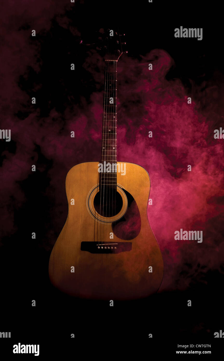 Acoustic Guitar In Smoke And Light Stage Environment Stock Photo
