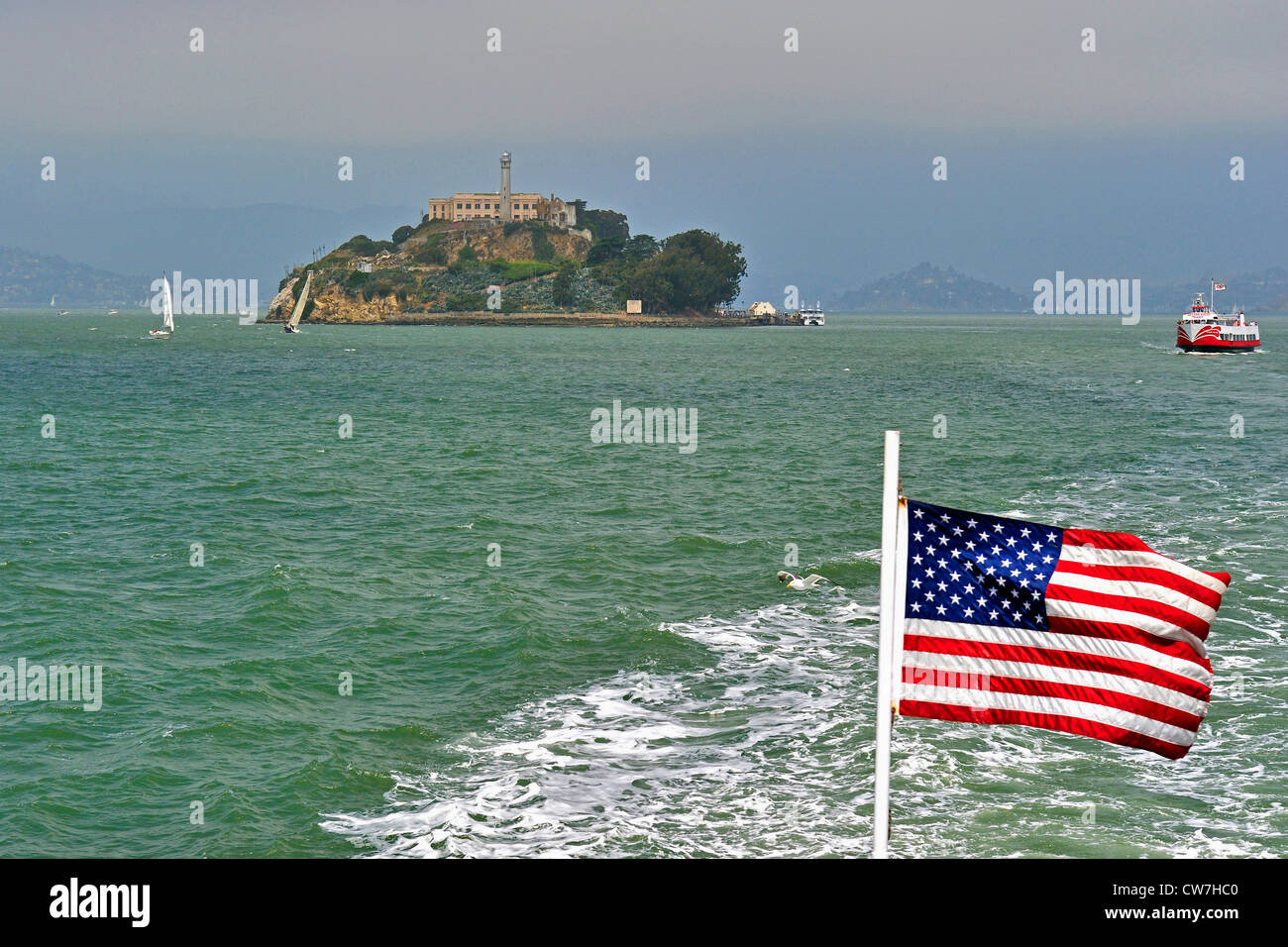 prison on Alcatraz Island and American Flag, USA, California, Alcatraz Island, San Francisco - Stock Image