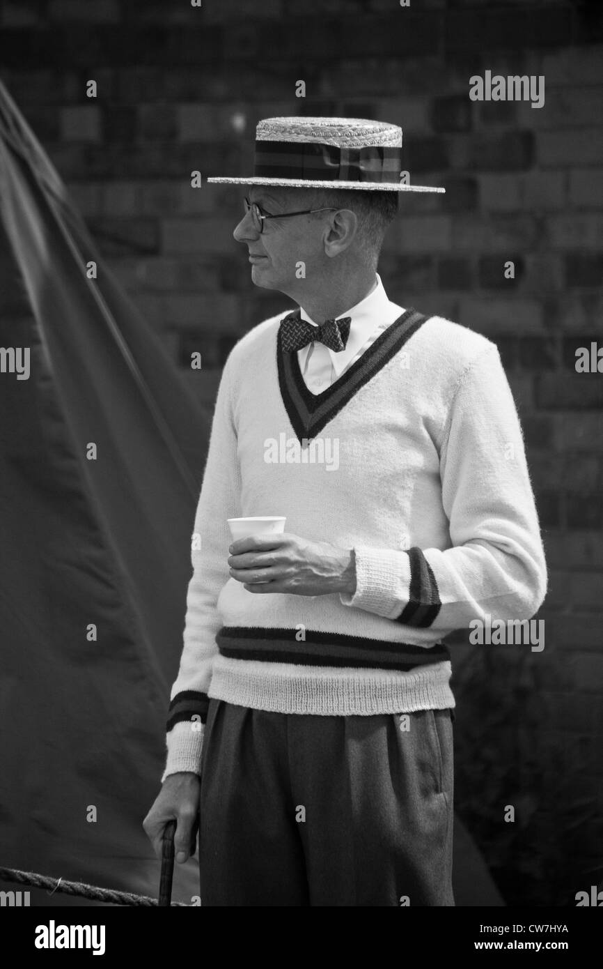 Gent in Straw Boater Hat Umbrella and Cricket Jumper - Stock Image