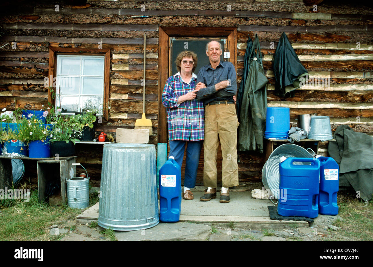 old gold-digger couple in front of their cabin at Brooks Range, USA, Alaska - Stock Image