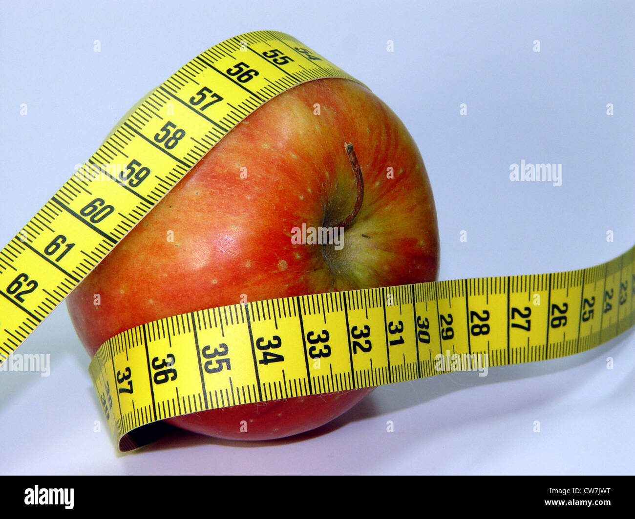 Symbol apple with measuring tage - Stock Image