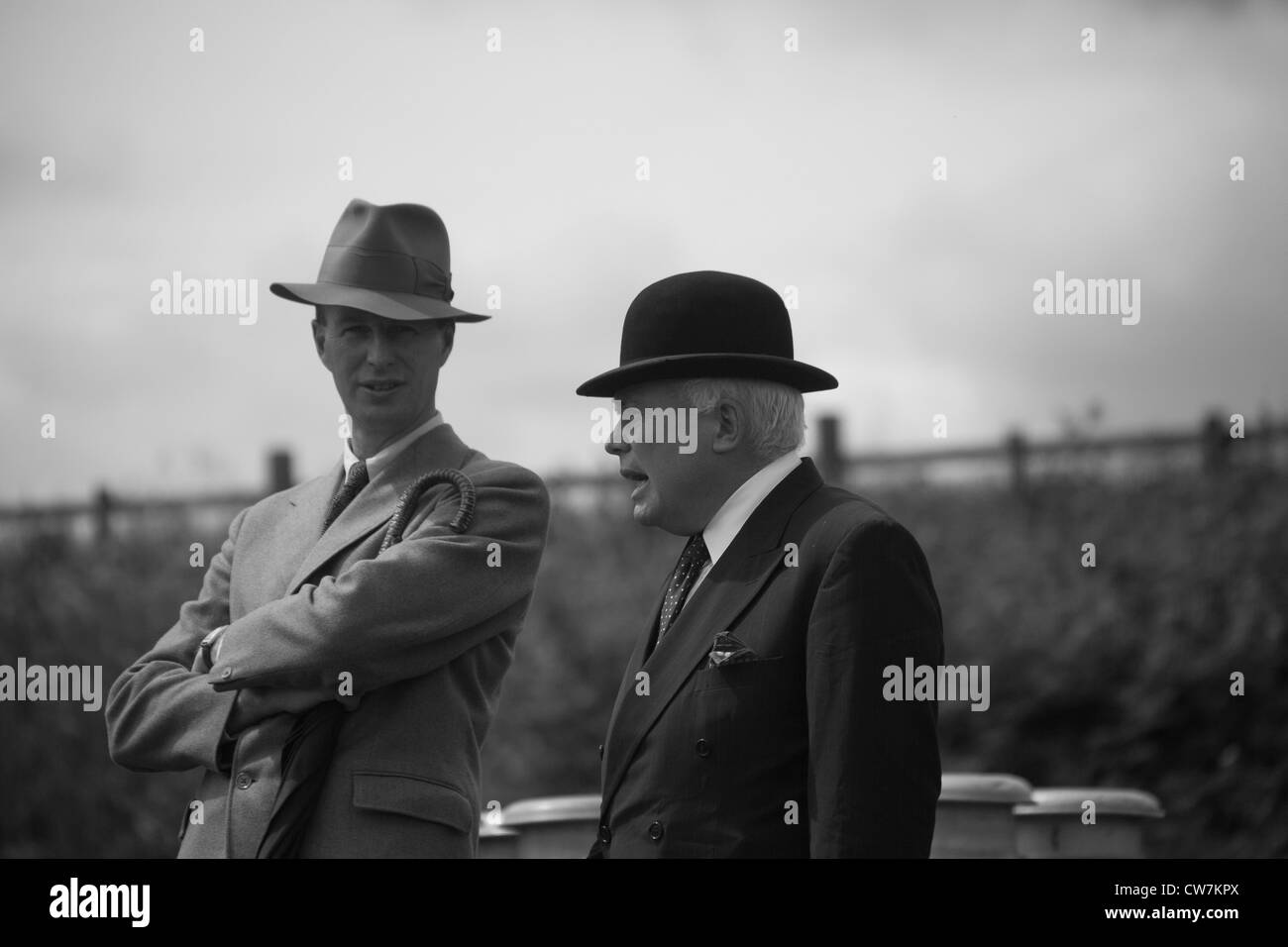 Gentlemen having a Morning Chat whilst waiting for the train. - Stock Image