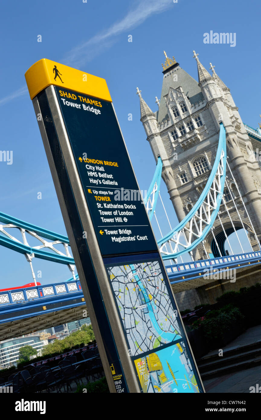 Legible streets sign and local map on south side of River Thames  in Southwark beside Tower Bridge London England - Stock Image