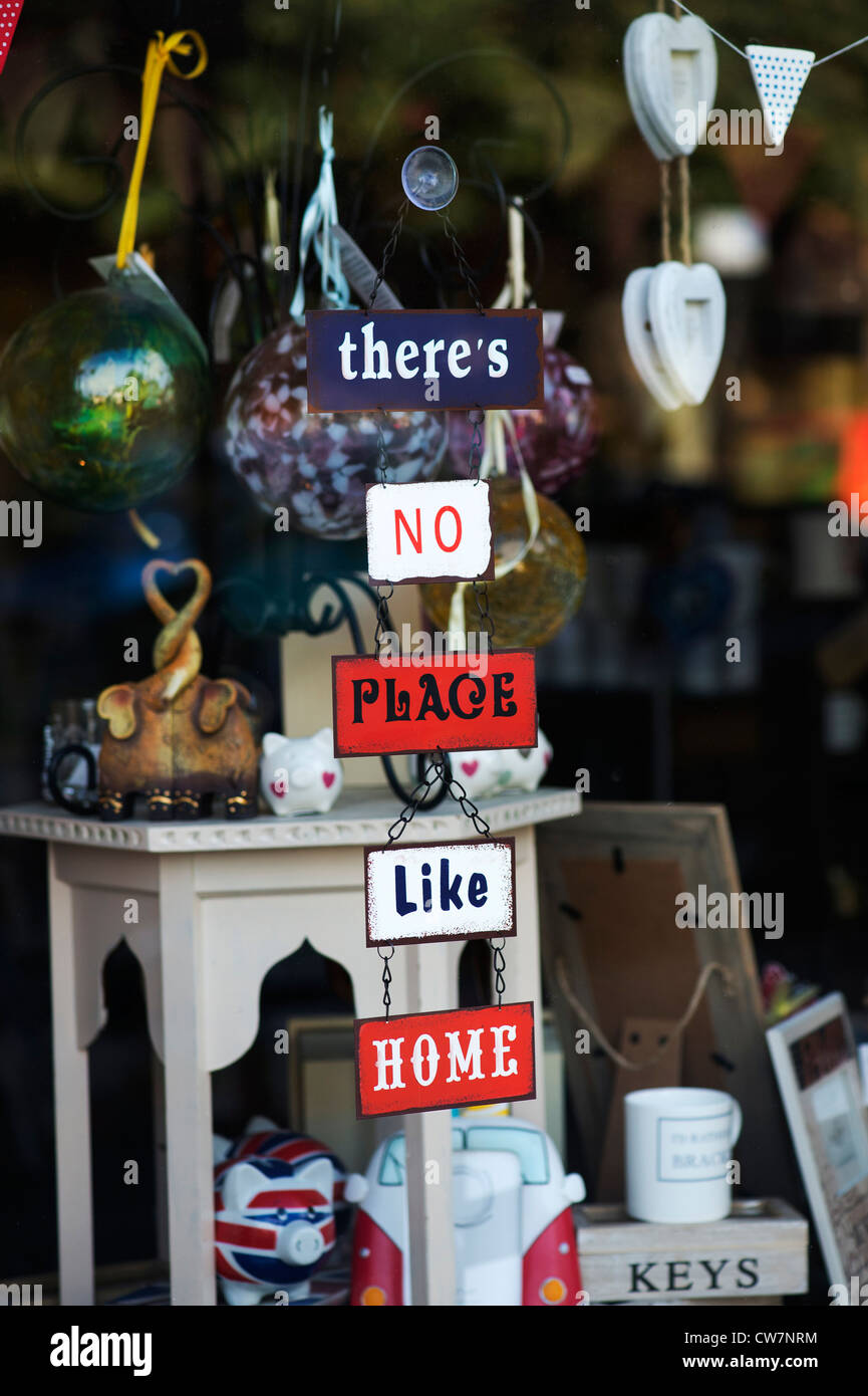 Theres no place like home signs in a shop window - Stock Image