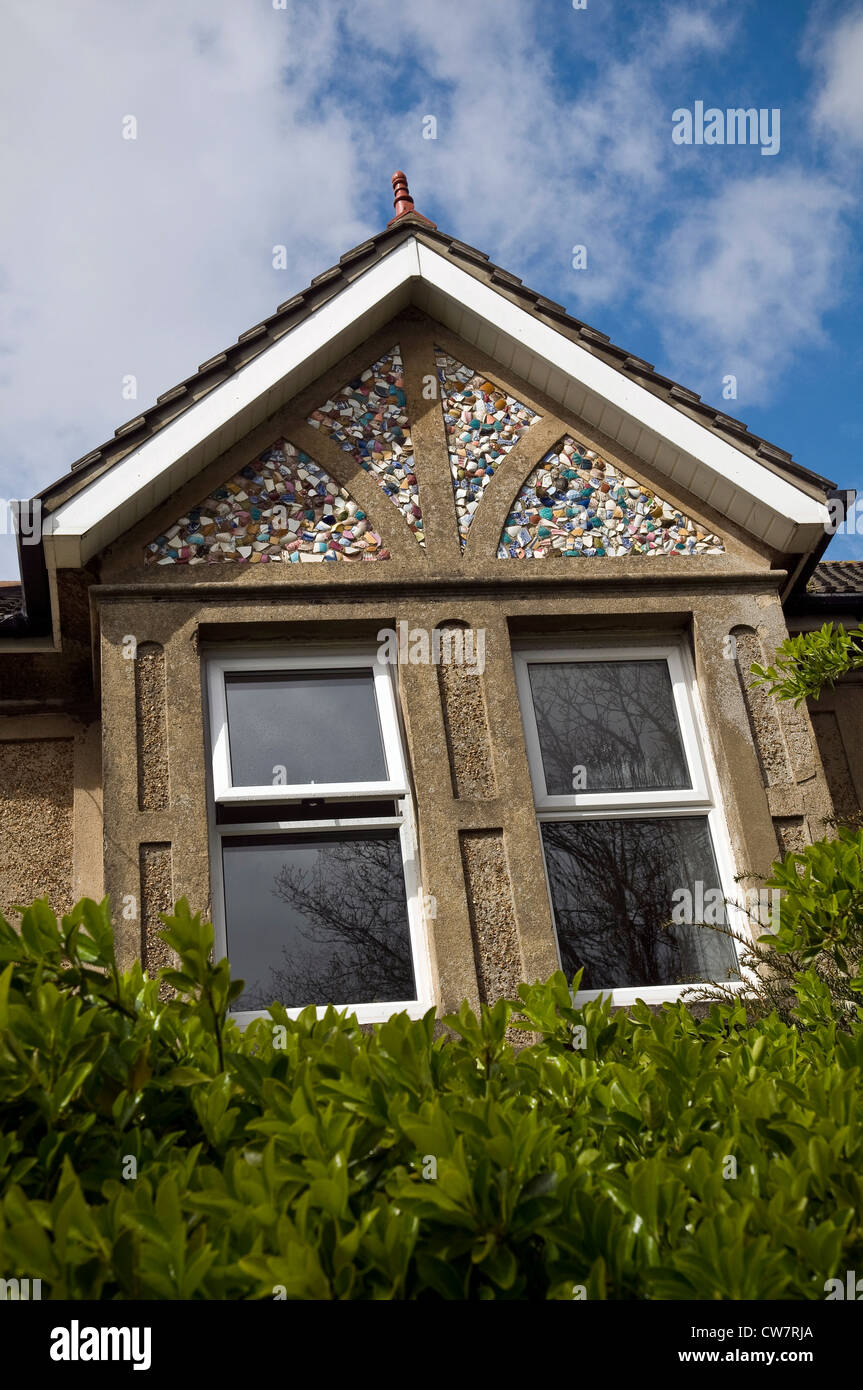 Unusual Edwardian house with gables decorated with broken pieces of ceramic crockery in Worthing, West Sussex, UK - Stock Image