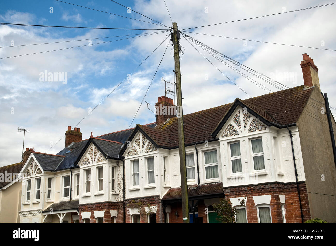 Unusual Edwardian houses with gables decorated with broken pieces of ceramic crockery in Worthing, West Sussex, - Stock Image