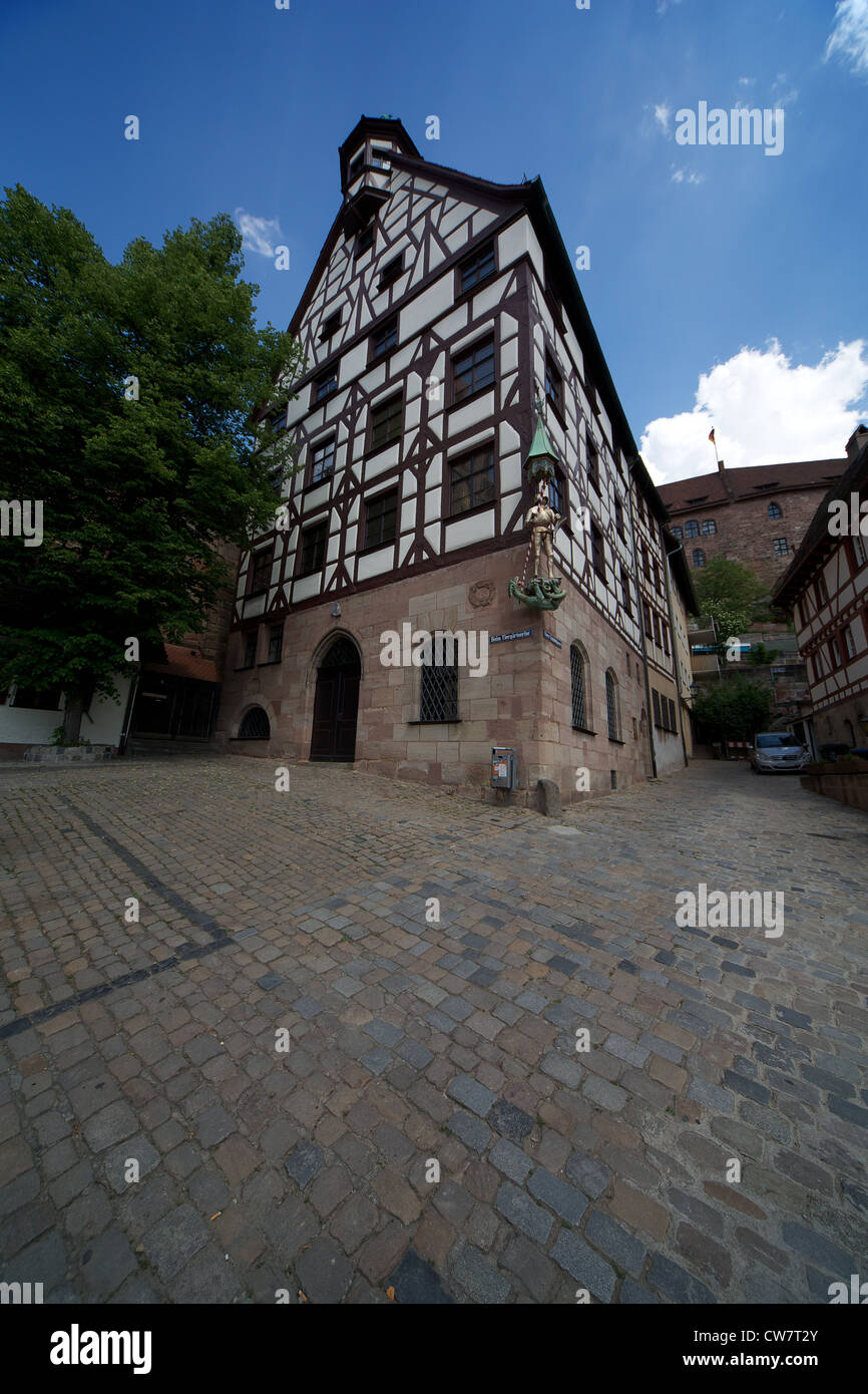 Old Tudor style house on the square in Nuremberg - Stock Image