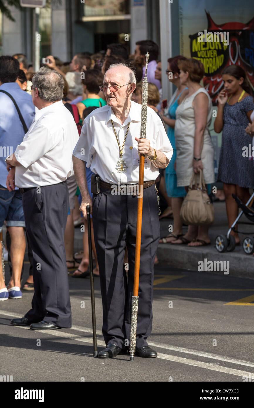 Elder worshiper in a reiligious procession - Stock Image