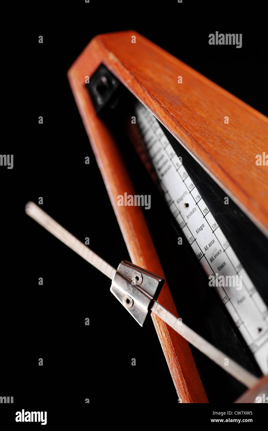 Vertical shot of a vintage metronome isolated on white - Stock Image