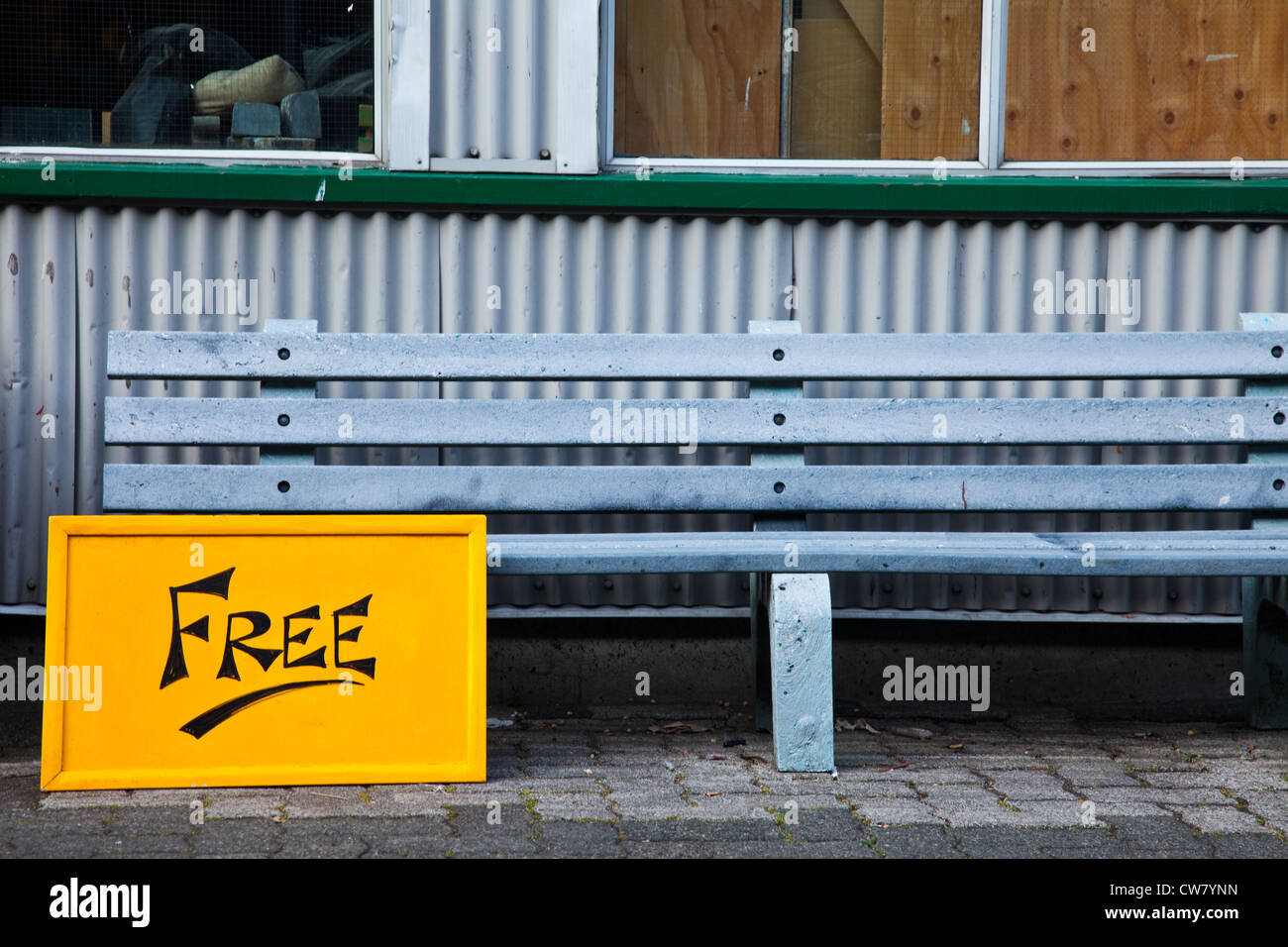 Humerous sign by a park bench on Granville Island, Vancouver, Canada - Stock Image