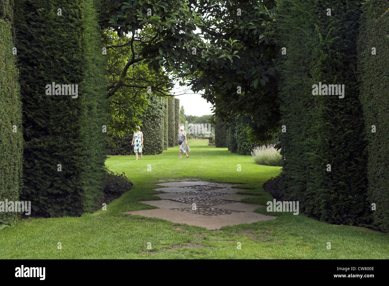 Visitors in the Ilex Avenue, Arley Hall and Gardens, Cheshire, UK - Stock Image