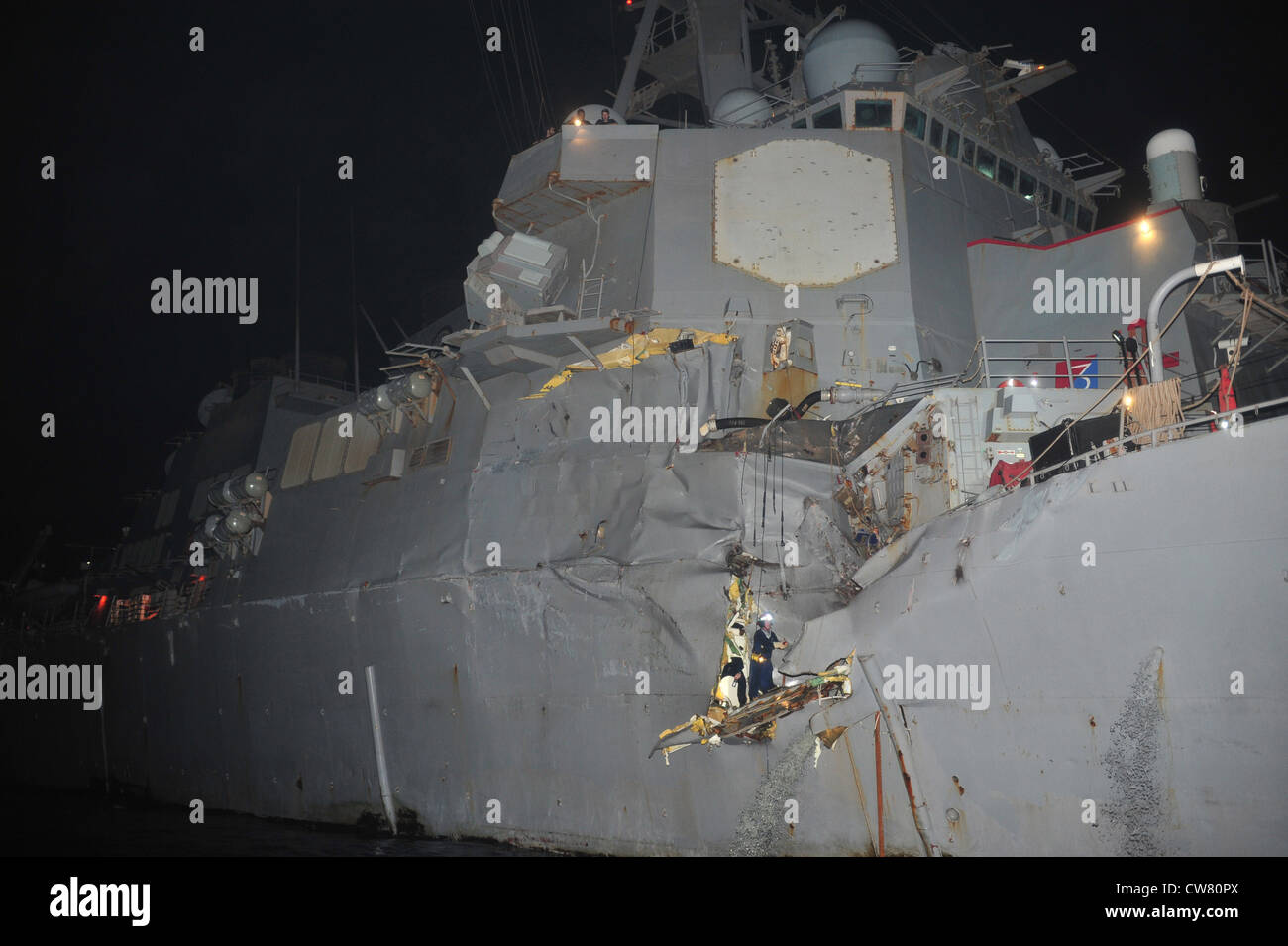 Guided-missile destroyer USS Porter (DDG 78) was damaged in a collision with the Japanese owned bulk oil tanker Stock Photo