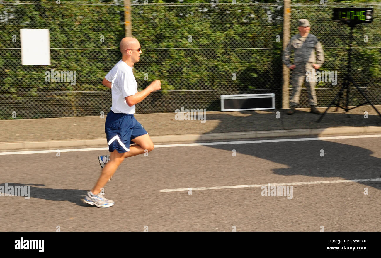 Larry Hagdorn, 100th Comptroller Squadron, sprints out the last few yards of the Team Mildenhall 5K Run at RAF Mildenhall, - Stock Image