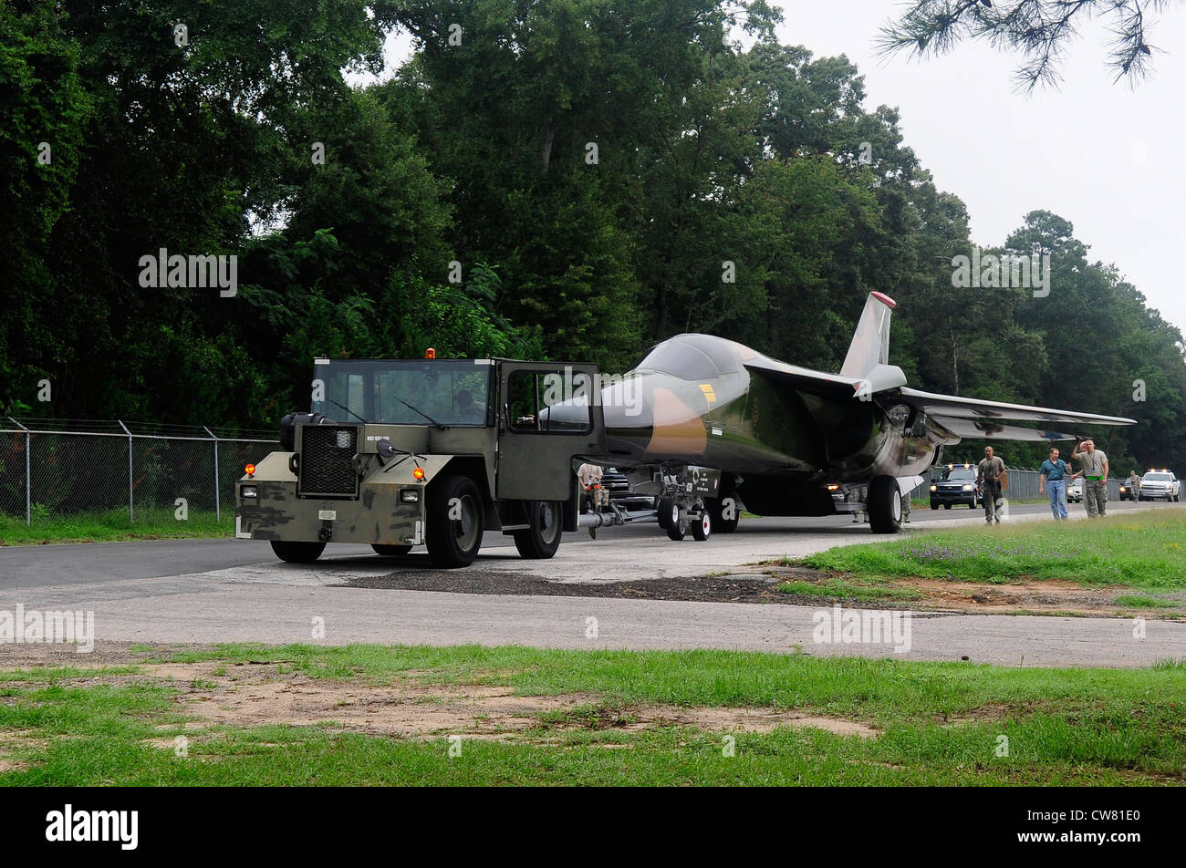 The F-111 Aardvark static display travels down Aiken Street accompanied by Team Shaw members at Shaw Air Force Base, - Stock Image